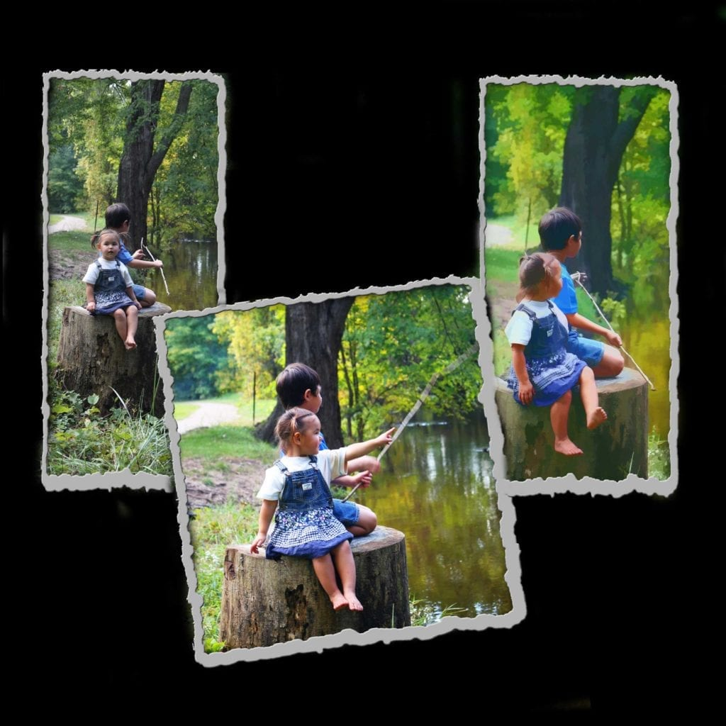 children on the riverbank wearing bib overalls