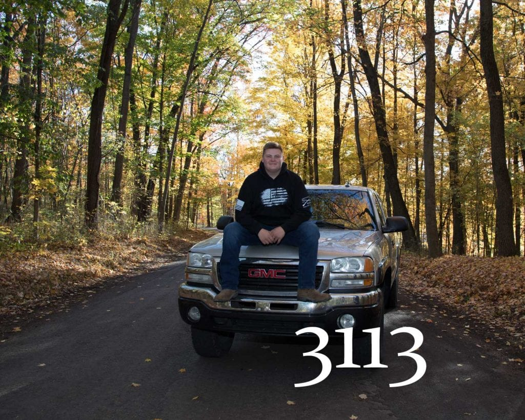 fall senior photos with truck and dirt bike